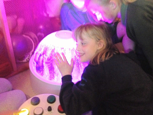Emi with her special sensory dome which we helped to fund. Looks like she is happy with it.