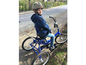 2016: Elliott on his new trike that we helped to fund for him and his brother.